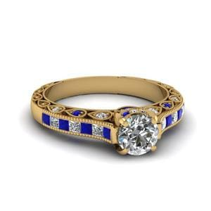 Round Cut Cathedral Setting Vintage Style Diamond Ring With Blue Sapphire In 14K Yellow Gold