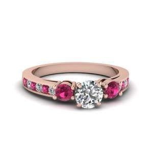 Round Cut Channel Three Stone Diamond Ring With Pink Sapphire In 14K Rose Gold