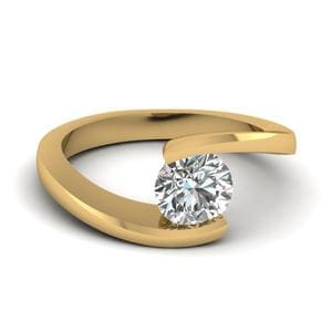 Tension Set Solitaire Engagement Ring In 14K Yellow Gold