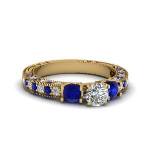 Vintage Style 3 Stone Round Diamond Engagement Ring With Sapphire In 14K Yellow Gold