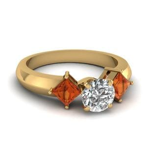 Kite Set 3 Stone Round Cut Engagement Ring With Orange Sapphire In 14K Yellow Gold