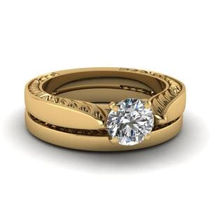 Tapered Engraved Round Cut Solitaire Wedding Ring Set In 14K Yellow Gold