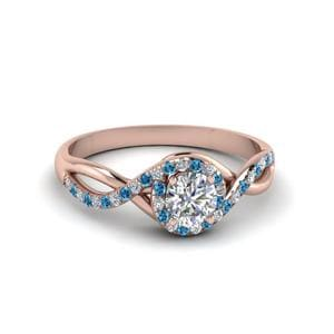Round Cut Twisted Halo Diamond Engagement Ring With Ice Blue Topaz In 14K Rose Gold