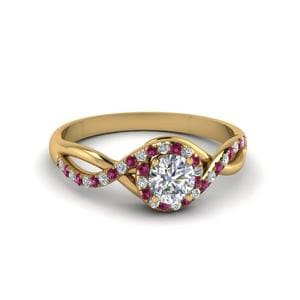 Round Cut Twisted Halo Diamond Engagement Ring With Pink Sapphire In 14K Yellow Gold