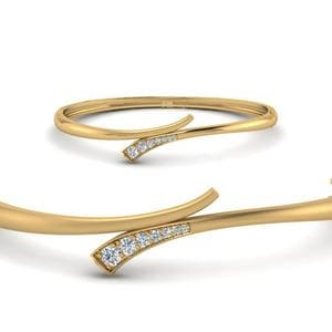 Seven Graduated Stone Diamond Swirl Bracelet Bangle In 14K Yellow Gold