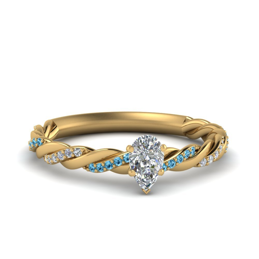 Twisted Delicate Pear Shaped Diamond Engagement Ring With Blue Topaz In 14K Yellow Gold
