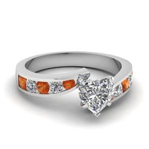 Heart Shaped Swirl Channel Diamond Ring With Orange Sapphire In 14K White Gold