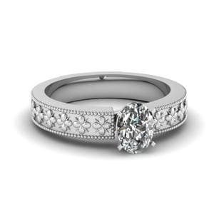 Floral Engraved Oval Shaped Solitaire Engagement Ring In 950 Platinum