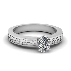 Oval Shaped Carved Solitaire Engagement Ring In 18K White Gold