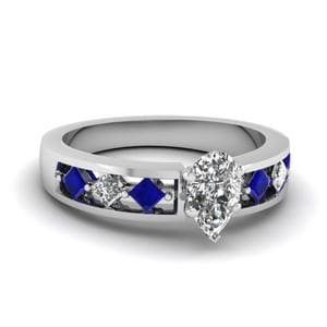 Kite Setting Pear Shaped Diamond Engagement Ring With Sapphire In 950 Platinum