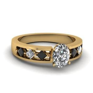 Kite Setting Oval Shaped Engagement Ring With Black Diamond In 18K Yellow Gold