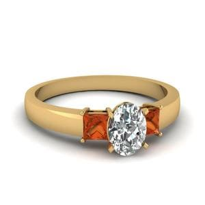 Dainty 3 Stone Oval Shaped Engagement Ring With Orange Sapphire In 14K Yellow Gold