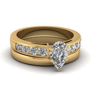 Pear Shaped Channel Diamond Ring With Plain Band In 18K Yellow Gold