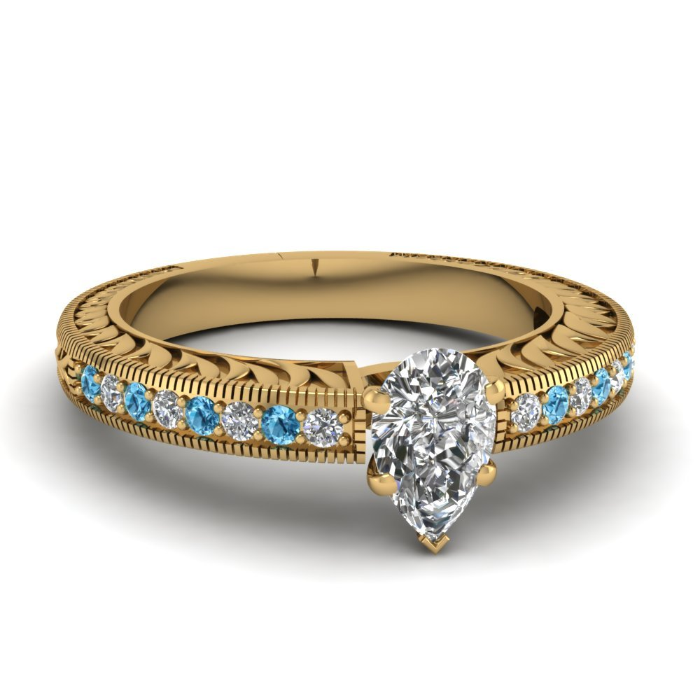Hand Engraved Pear Shaped Vintage Engagement Ring With Blue Topaz In 18K Yellow Gold