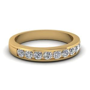 Round Diamond Channel Wedding Band In 14K Yellow Gold